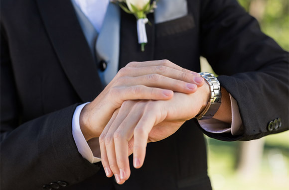 Photo: Groom Checking Time via Shutterstock