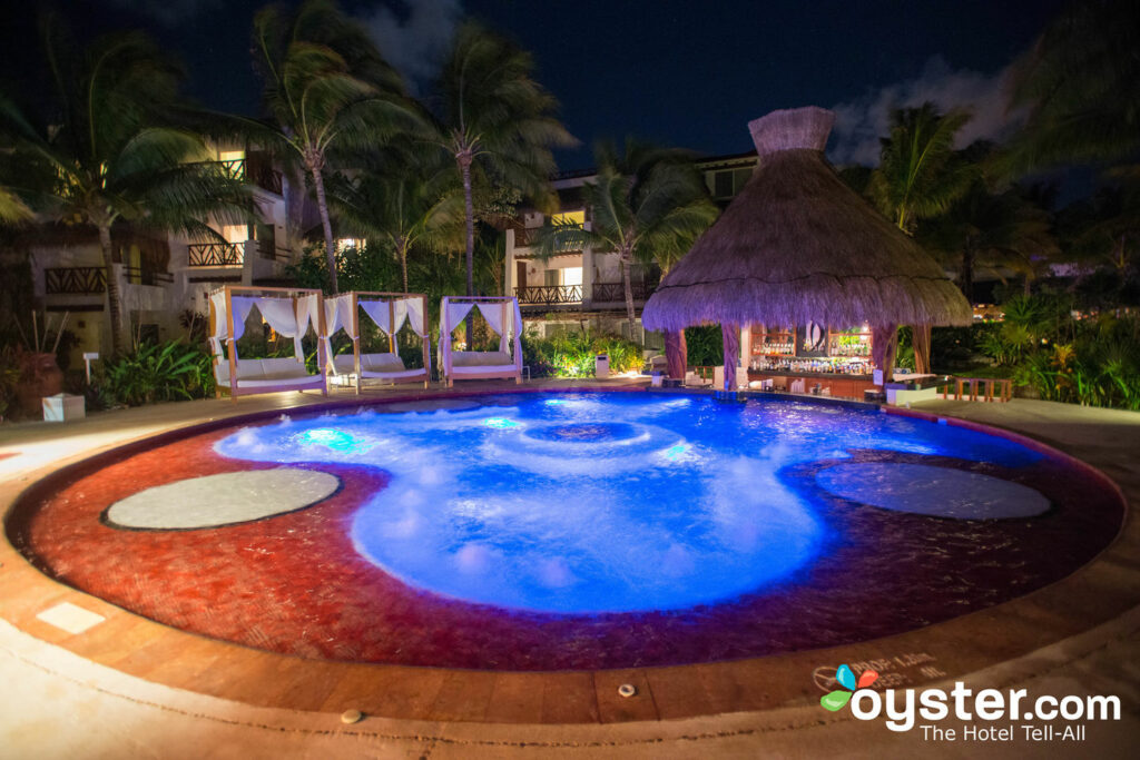"""Wet Spet"" pool area at night at the Desire Riviera Maya Pear Resort"