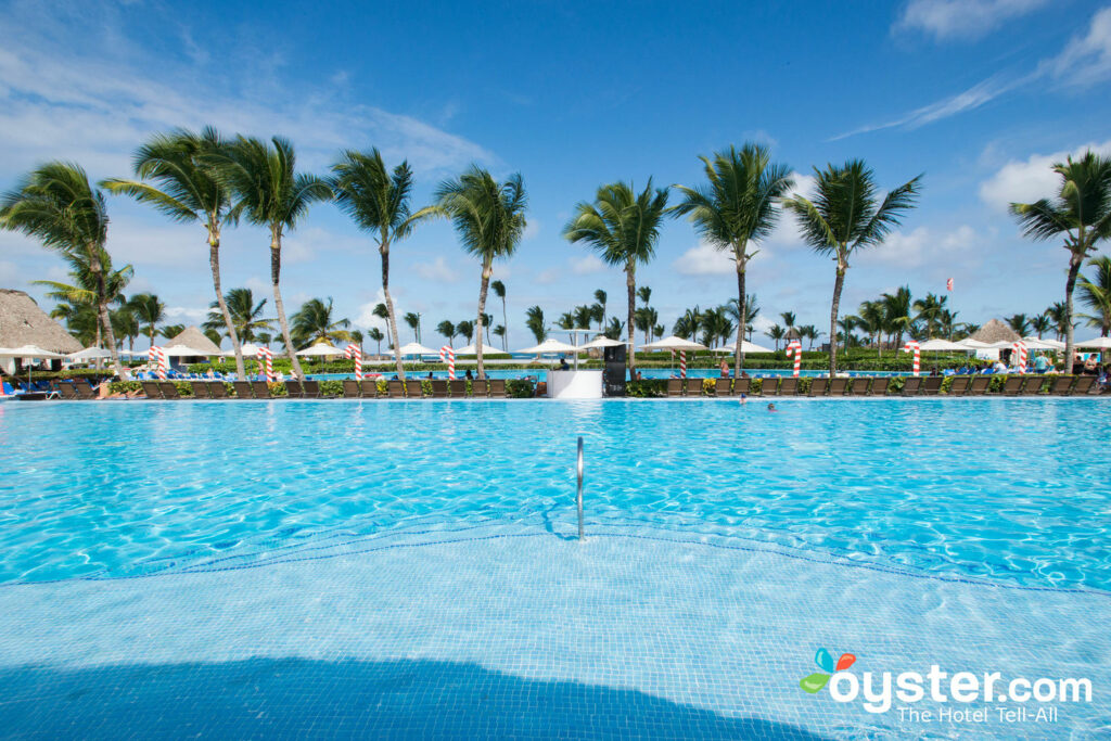 Beautiful Pool surrounded by Palm Trees at All-Inclusive Hard Rock Hotel and Casino in Punta Cana
