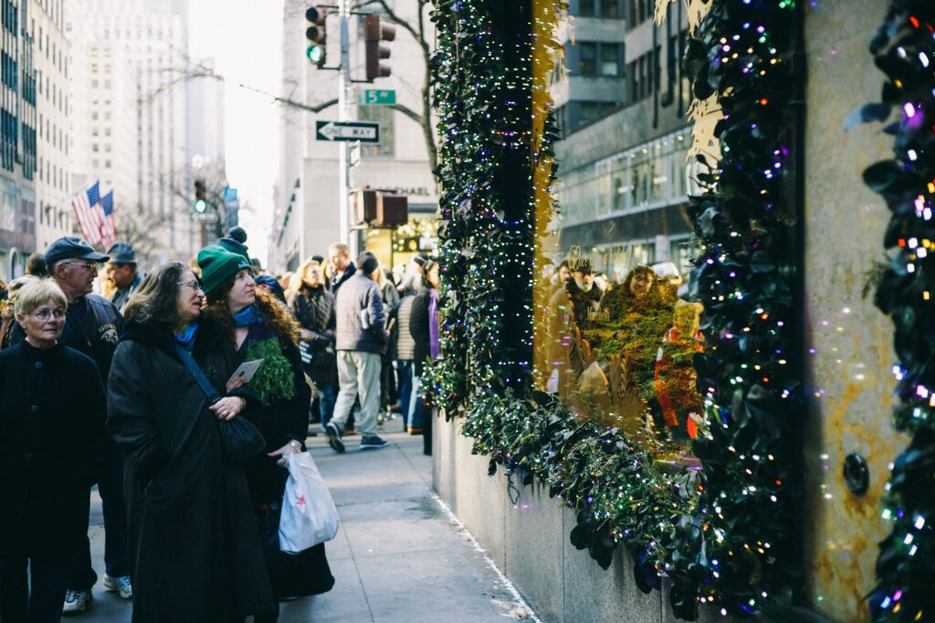 People looking at winds on Saks Fifth Avenue, New York, United States