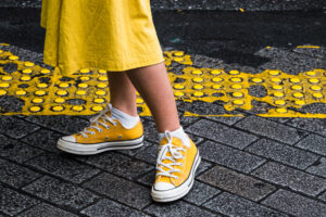 Yellow Converse on a woman