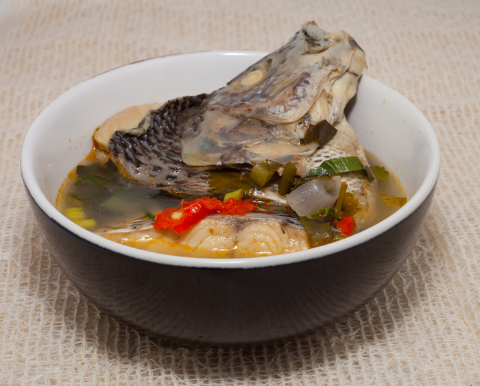 We recommend trying local delicacies, like fish head curry when in Singapore.