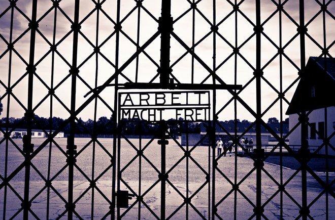"Entrance gates to Dachau which read ""Work makes you free""; Photo credit: Katherine Alex Beaven"