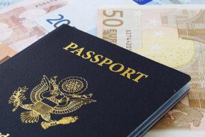 Photo: American passport and euro banknotes via Shutterstock