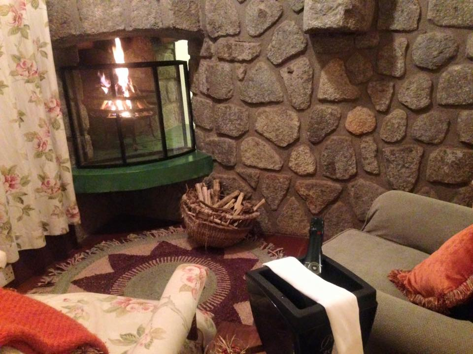 Fireplace and champagne at Gibb's Farm
