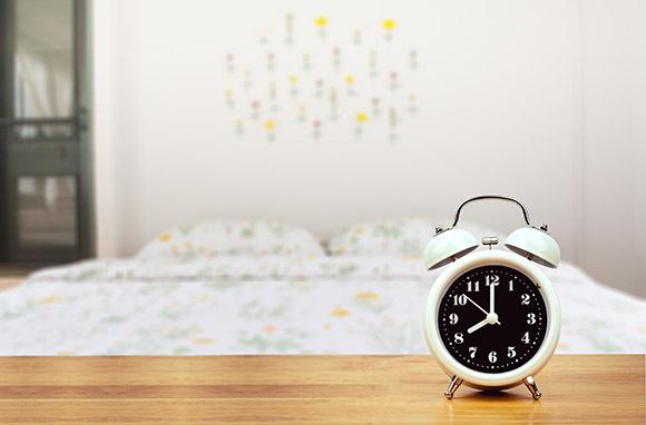 Photo:Alarm Clock in Bedroomvia Shutterstock