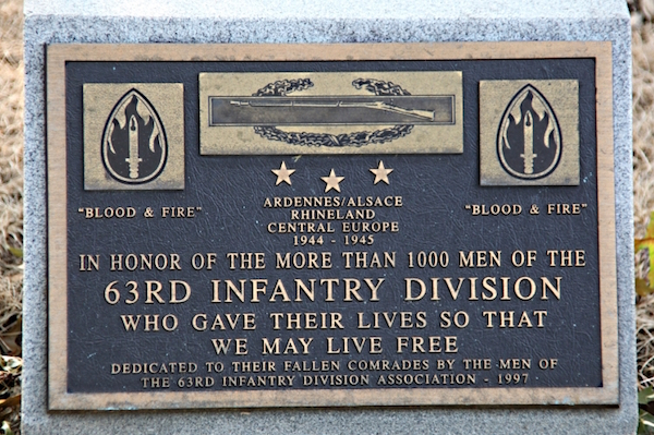 Memorial plaque at Arlington National Cemetery (Photo Courtesy Of: Wikimedia Commons)