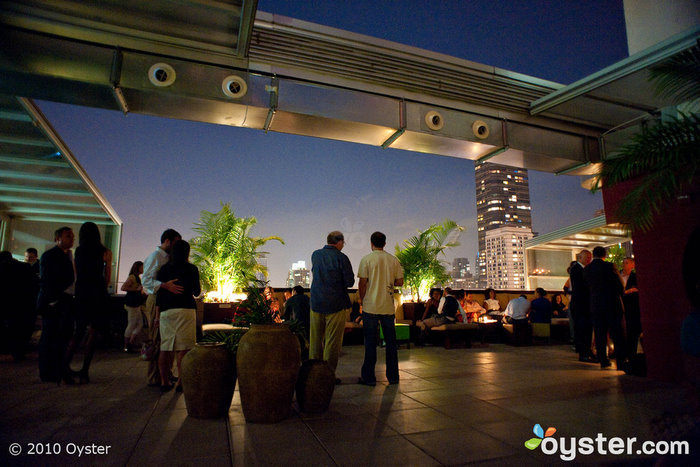 The Empire Hotel's rooftop features a bar, a pool and an old-fashioned neon sign.