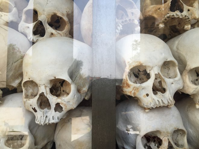 Skulls at the Killing Fields at Choeung Ek; image courtesy of Kyle Valenta.