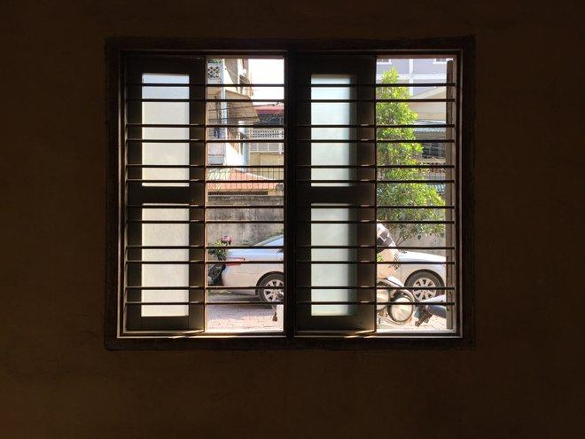 Through the windows of Tuol Sleng to the street; image courtesy of Kyle Valenta.