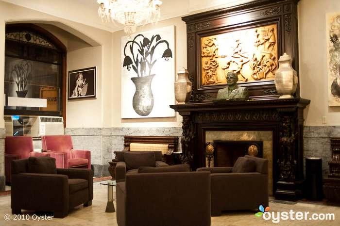 Artwork from hotel residents hangs in the lobby at Hotel Chelsea.