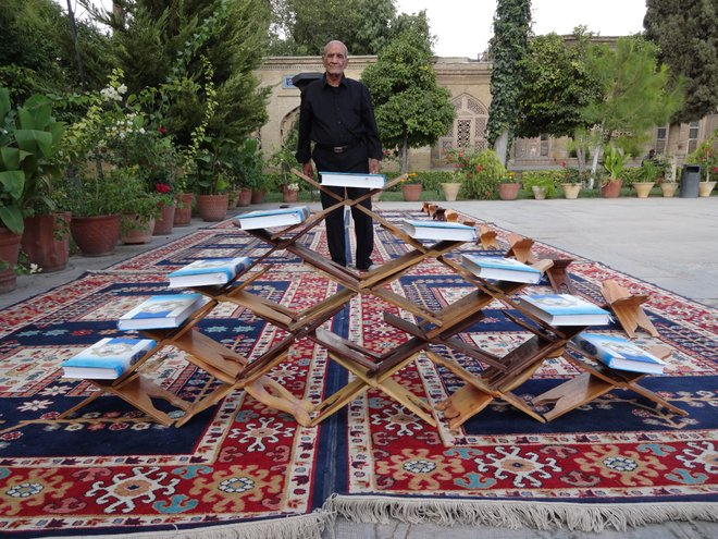 A man and his Qurans at the Tomb of Hafez in Shiraz; Photo by Chris Nielsen