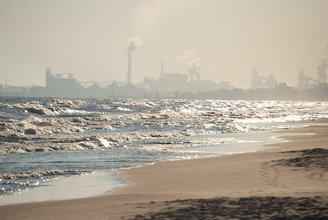 A factory sits next to a beach. Steve Johnson/Flickr