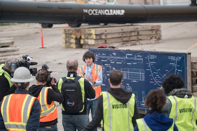 The Ocean Cleanup's founder with system blueprints/Courtesy of The Ocean Cleanup