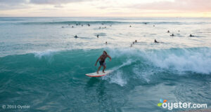 Sunset Surfing in Waikiki, Oahu, Hawaii