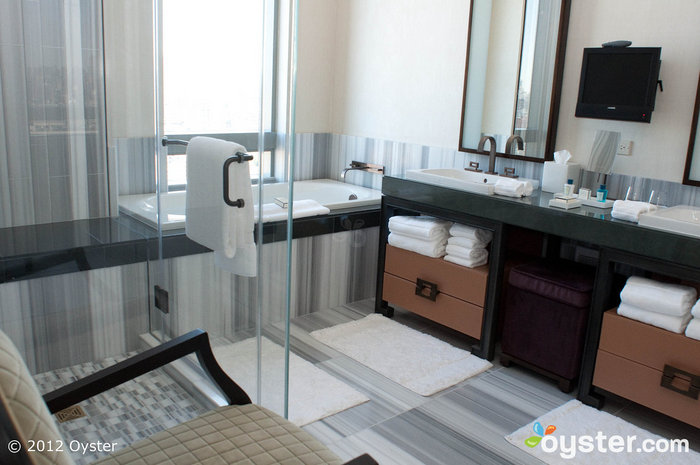 The bathrooms in even the Trump's standard rooms are divine, with flat-screen TVs, deep soaking tubs, and separate showers.