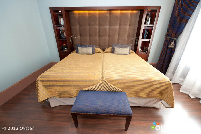 Elegant rooms are equipped with flat-screen TVs, surround sound systems and minibars.