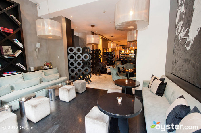 The hotel's chic bar, Marfil, features outdoor seating where diners can enjoy cocktails and small plates.