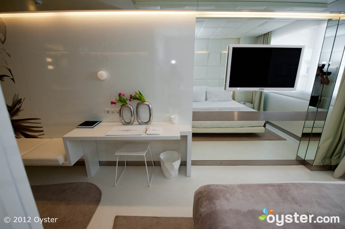 Sleek rooms featurehigh-tech amenities, free Wi-Fi, upscale bedding and furnished patios or balconies.