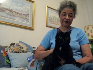 Pet psychic Catherine Ferguson at home with one of her cats.
