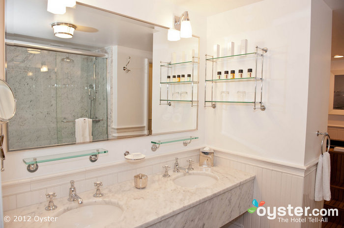 Marble bathrooms at Mr. C feature his-and-hers vanities.