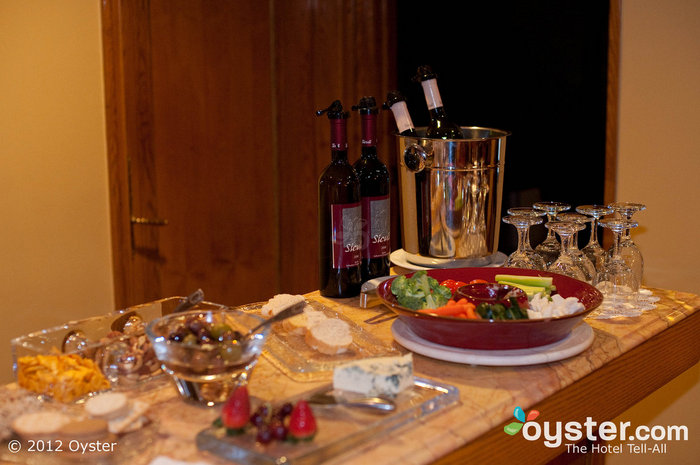 Guests meet in the Club Room at Hotel Elysee to enjoy free snacks and wine.