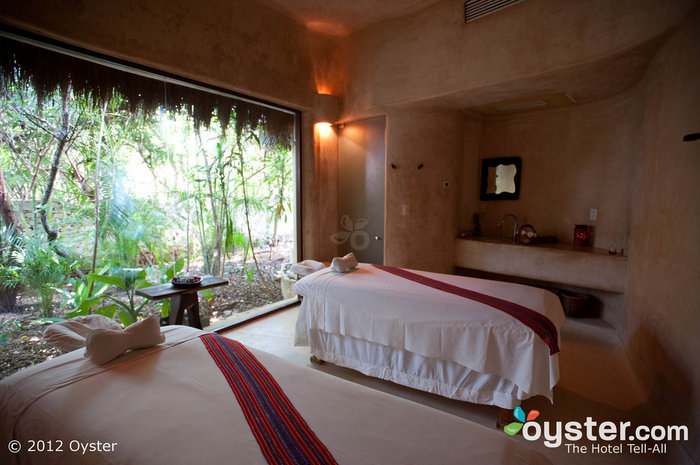 Esencia's Aroma Spa features gorgeous treatment rooms with views of the hotel's lush grounds.