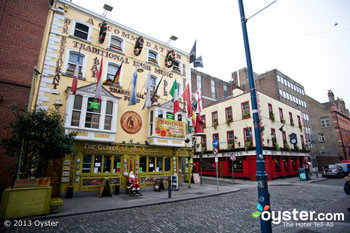 Pubs along Dublin's Temple Bar beckon visitors with their traditional bites and brews.