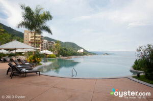 The infinity pool at Garza Blanca offers stunning views of Puerto Vallarta's rugged coastline.