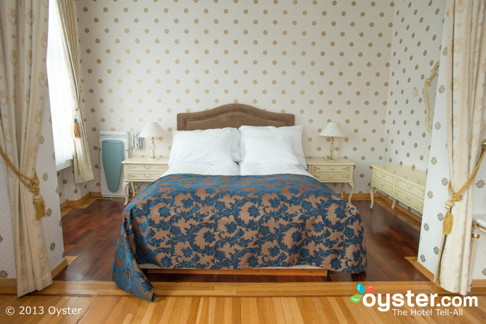 Rooms have charming decor details such as wood paneling and chandeliers.