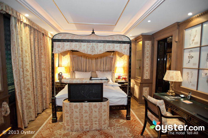 Luxurious rooms feature four-poster canopy beds and fresh cut roses.