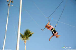 A resortguest gets free trapeze lessons at the Viva Wyndham Dominicus Palace Resort.