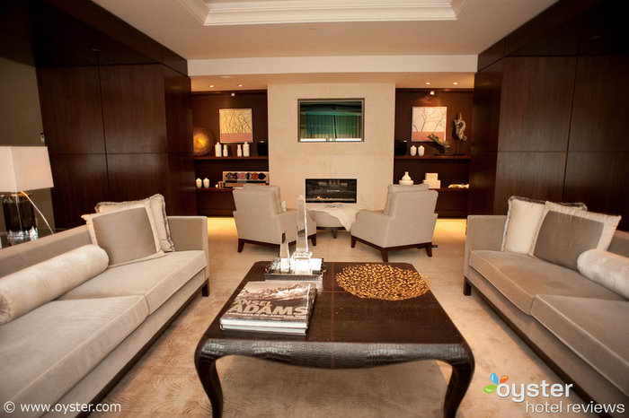 Wood paneling and a gas fireplace make The Presidential Suite West Wing feel inviting.