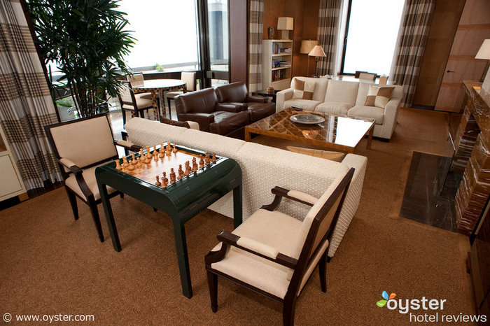 The Presidential Suite at the Four Seasons New York features satinwood games tables and a working gas fireplace.