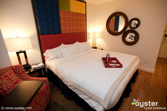 Hotel Indigo's cheery rooms are comfortable and well-equipped, perfect for fans who drag their significant other along.