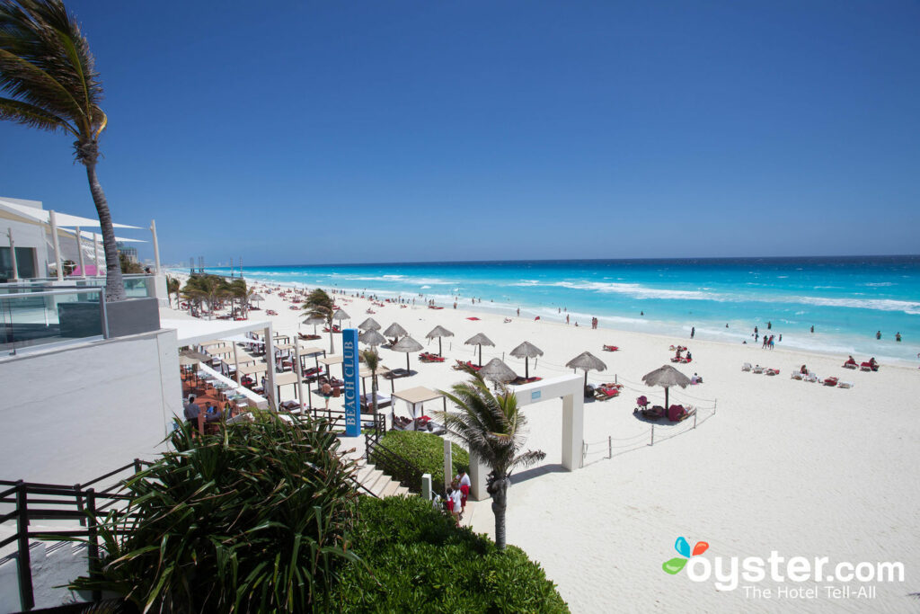 The beach scene at Oasis Cancun
