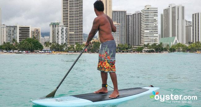 A surfer balances atop his board at Waikiki Beach, Oahu