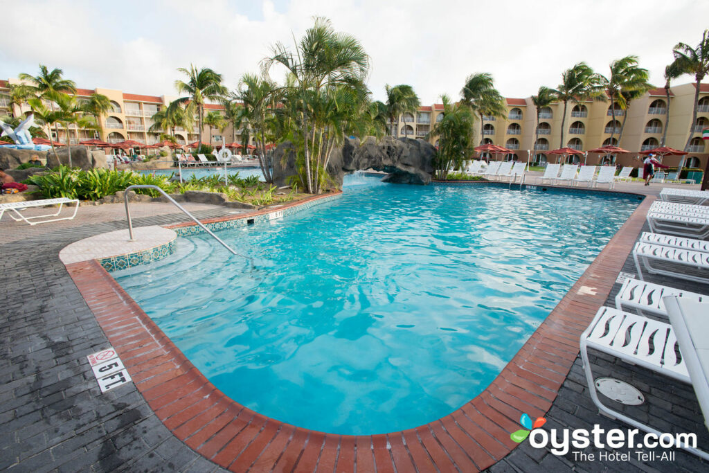 Get sun-soaked beach views, a lively happy hour, and a waterslide at the La Cabana pool.