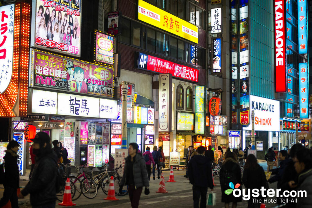The bright lights of Shinjuku hold Kabukicho's host and hostess clubs.