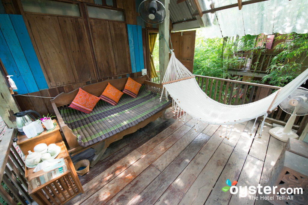 Porch of the Villa Rustic Tree House Room at BaanBooLoo Traditional Thai Guest House