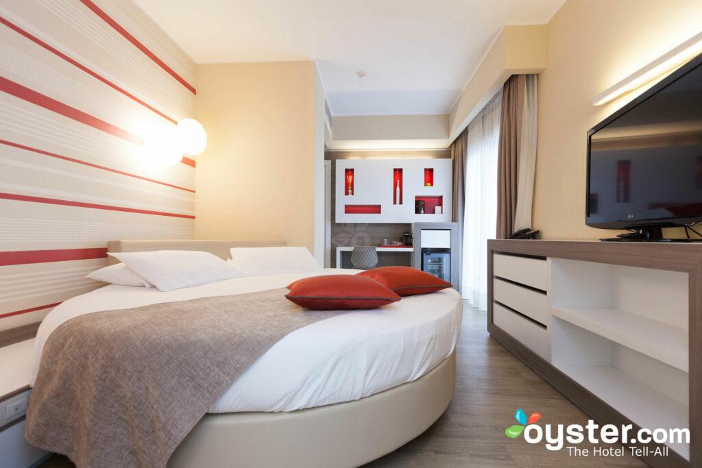Desfrute de um quarto Sweet no Enjoy Garda Hotel