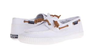 White slip-on boat shoes by Sperry.