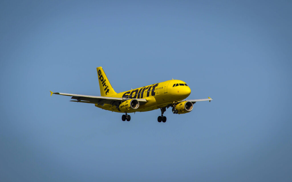 Yellow Spirit Airlines Airplane in the Sky