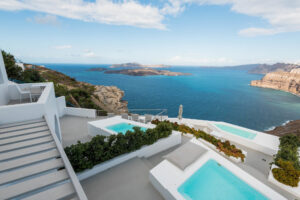 Overhead view of pools and sea at Alti Santorini Suites