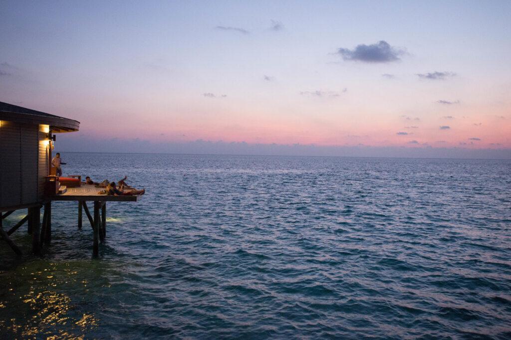 The Centara Ras Fushi Resort & Spa Maldives at sunset