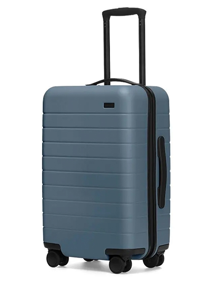 Carry-on suitcase by Away in blue