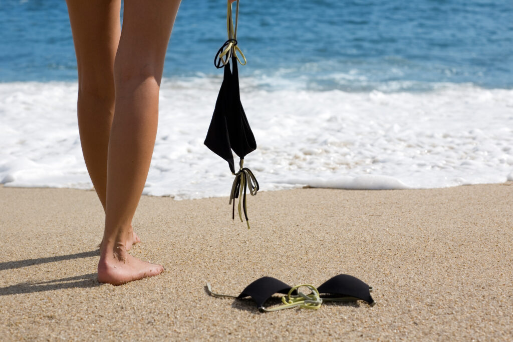 Woman standing on beach with bikini