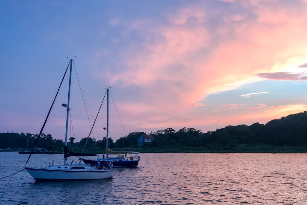 Sunset on the water with boats in Bristol, Rhode Island