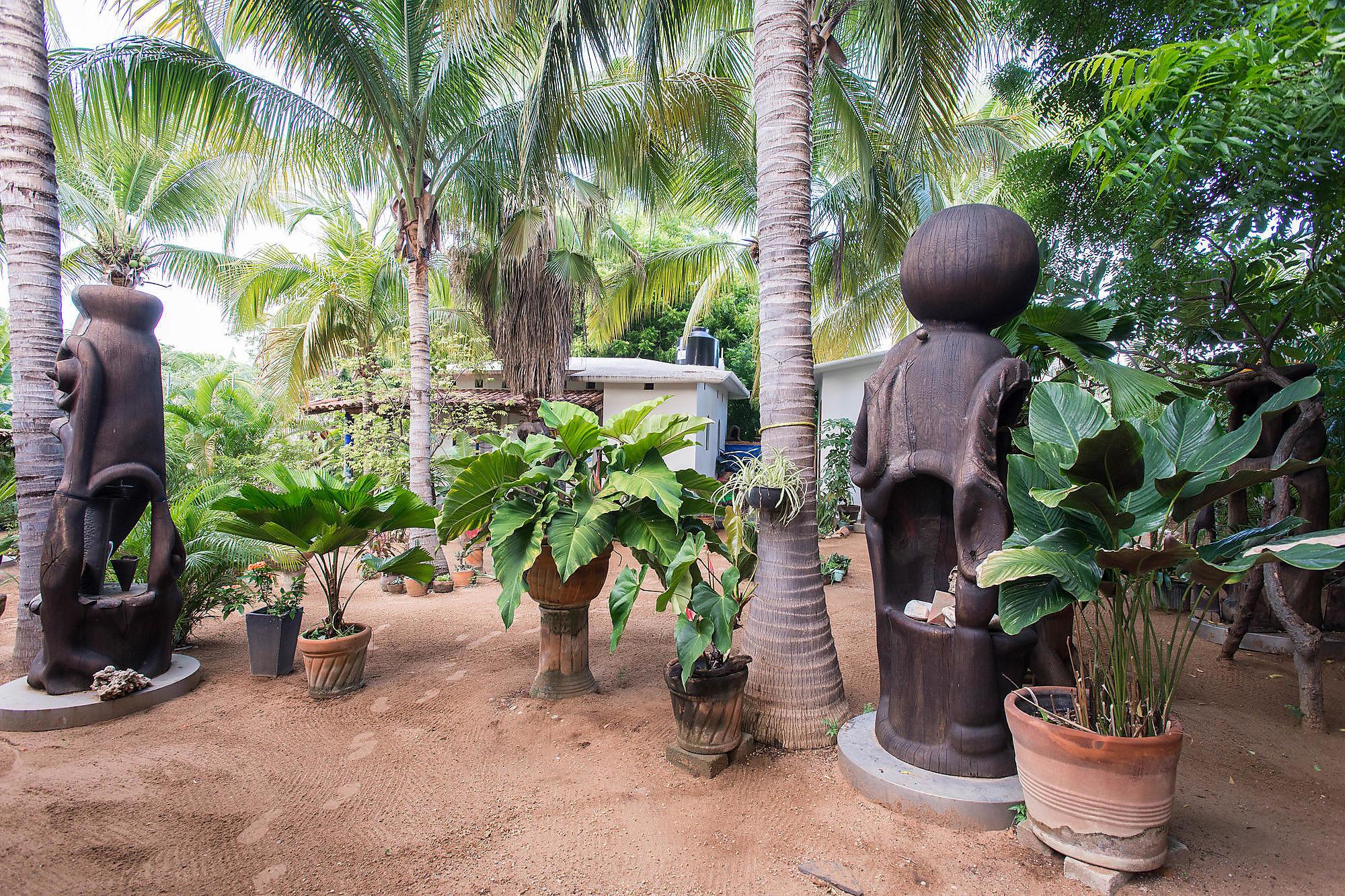 The leafy grounds and cool art at Villa Mozart y Macondo in Puerto Escondido, Oaxaca.