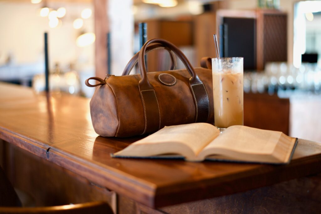 Bag, book and ice coffee